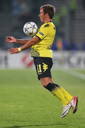 Man Utd targets: Mario Goetze of Borussia Dortmund controls the ball on his chest
