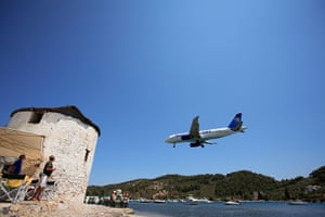 Thomas Cook: A Thomas Cook holiday charter jet landing in Skiathos, Greece, in 2008