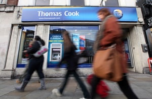 Thomas Cook: Pedestrians pass a branch of Thomas Cook in London