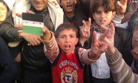 Boy shouts during a protest against Syria's President Bashar al-Assad