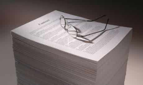 A pile of papers representing a multi page legal contract