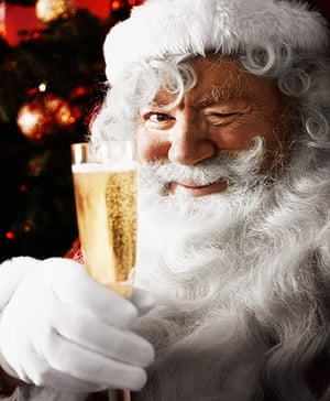 10 best christmas songs father christmas holding glass of champagne - Best Classic Christmas Songs