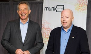 Christopher Hitchens poses with former prime minister Tony Blair