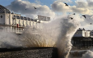 UK Weather: Waves crash on the seafront near Brighton Pier in Brighton, East Sussex