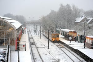 UK Weather: A train pulls in to a snow covered Monkseaton Metro station, North Tyneside