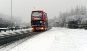 UK Weather: A bus struggles in heavy snow on the roads in Gateshead