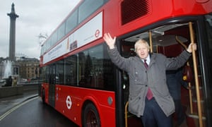 Mayor of London Boris Johnson waves from the back of a prototype of a new style London bus in London