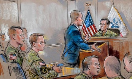 Bradley Manning, second from left, sits as his attorney speaks during a military hearing