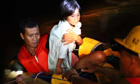 Rescuers carry a girl to safety in Cagayan de Oro