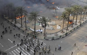 Tahrir Square clashes: Egyptian army soldiers run during clashes at Tahrir Square