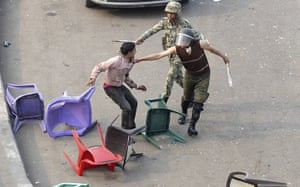 Tahrir Square clashes: Egyptian army soldiers arrest a protester at Tahrir Square