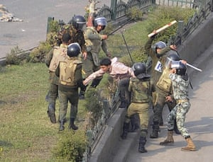 Tahrir Square clashes: Egyptian army soldiers arrest a protester during clashes at Tahrir Square