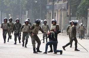 Tahrir Square clashes: Egyptian soldiers arrest a woman during clashes with military polic