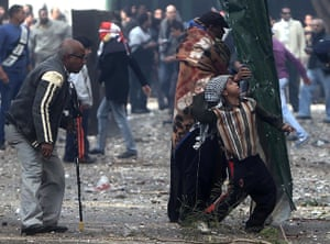 Tahrir Square clashes: Young Egyptian protesters throw rocks at military police