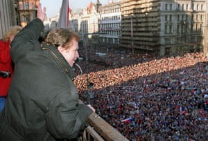 Vaclav Havel: 1989: Vaclav Havel waves to the crowd gathered on Prague's Wenceslas Square