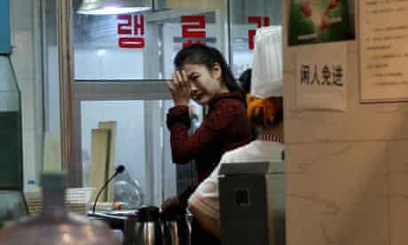 A waitress cries in a North Korean restaurant in Beijing