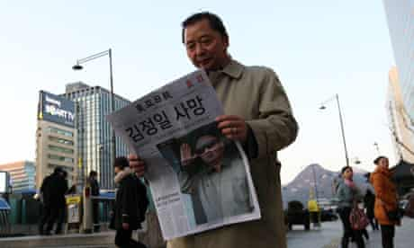 A South Korean citizen reads about the death of Kim Jong-il
