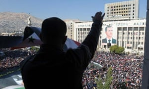 Syrians demonstrating against the Arab League's decision to impose sanctions on the country