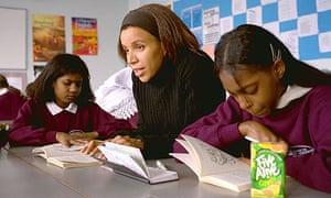 Woman helping schoolchildren read