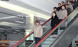 Kim Jong-il on an escalator