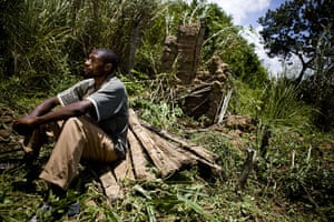Year in MDG: Jean-Marie Tushabe pictured on the site where his house was burned down.