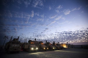 FTA: Lucas Jackson: The sun rises as soldiers prepare for a mission at Camp Adder
