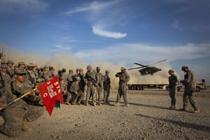 FTA: Lucas Jackson: Soldiers from the 3rd Brigade Combat Team hold their unit's flag