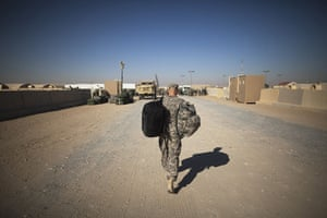 FTA: Lucas Jackson: A soldier carries bags on his trip back to the US at Camp Virginia, Kuwait