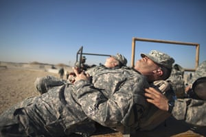 FTA: Lucas Jackson: Soldiers sleep while waiting for processing at Camp Virginia, Kuwait