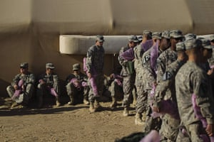 FTA: Lucas Jackson: Soldiers stand in line to pack their weapons for shipment back to the US