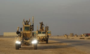 FTA: Lucas Jackson: Soldiers celebrate through the roof hatches of their MRAP vehicles