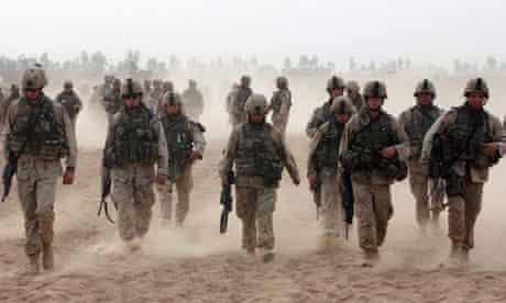 US soldiers return to their barracks at a military base outside Fallujah