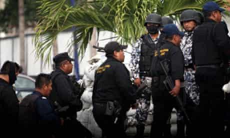 Veracruz police walk past Mexican navy marines