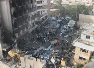 Iraq bombing: Iraqi security forces gather the scene of a car bomb attack in Baghdad