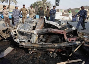 Iraq bombing: Iraqi security forces and people gather the scene of car bomb attack, Iraq