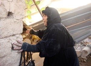 Iraq bombing: A woman reacts after a bomb attack destroyed her makeshift house