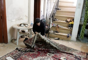 Iraq bombing: An Iraqi woman inspects damage in her house at Karada district