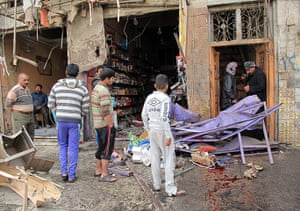 Iraq bombing: Iraqis inspect the damage after a wave of attacks