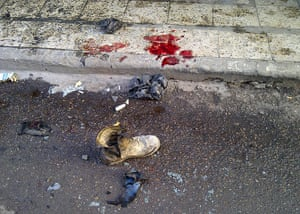 Iraq bombing: A soldier's boot and blood stains on the ground in Alawi , Baghdad