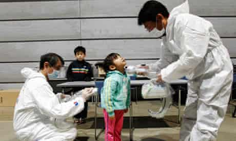 A five-year-old girl is tested for radiation exposure