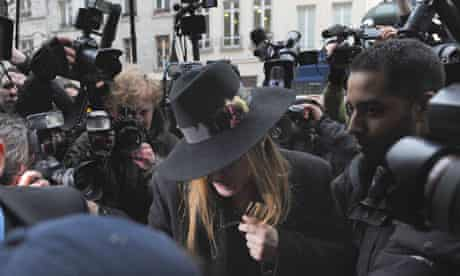 John Galliano arrives at a police station in Paris in February this year