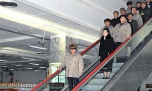 Kim Jong-il rides an escalator