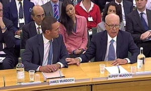 James Murdoch (with his severe buzzcut) and father Rupert giving evidence.