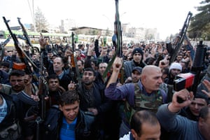 Damascus Suicide Bombing: Members of Syrian security chant slogans