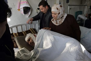 Damascus Suicide Bombing: A wounded man rests at a hospital in Damascus