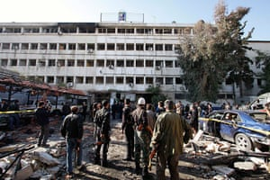 Damascus Suicide Bombing: People stand at the site of the suicide bombing