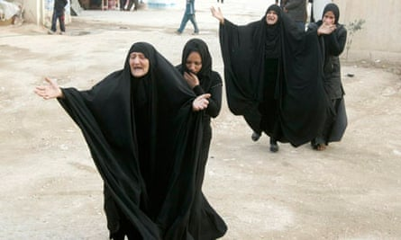 Women mourn during a funeral of a victim who was killed in one of Thursday's bomb attacks