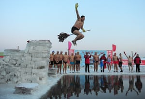 24 hours in pictures: A swimmer jumps into the icy water of the Songhua River