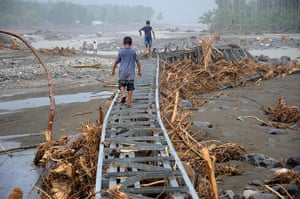 24 hours in pictures: Boys play on a destroyed bridge in Iligan City, Philippines