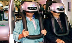 Japanese men enjoying virtual reality driving